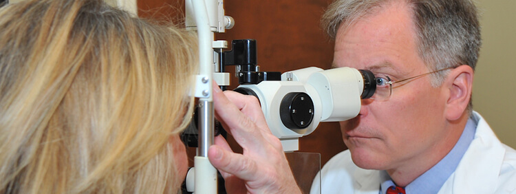 Ophthalmologist performing a glaucoma exam on patient