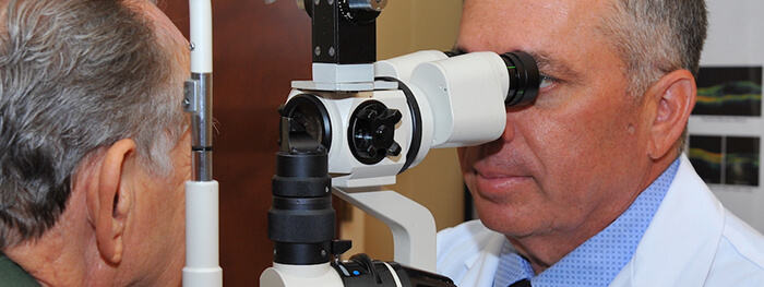 Doctor checking a patient for macular degeneration