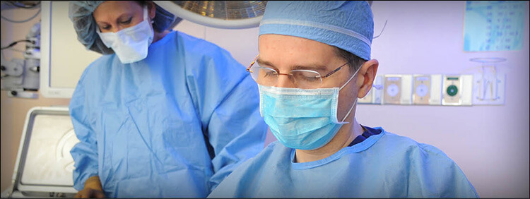 Ophthalmologist performing oculoplastic surgery
